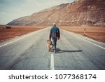 man walking on the road with... | Shutterstock . vector #1077368174