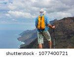 hike in na pali coast in kauai... | Shutterstock . vector #1077400721