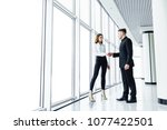 handshake. male and female... | Shutterstock . vector #1077422501