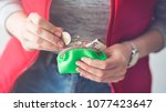 woman gets money from the wallet | Shutterstock . vector #1077423647