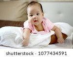 shooting 3 month infant baby | Shutterstock . vector #1077434591