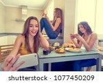 teen girls best friends having... | Shutterstock . vector #1077450209