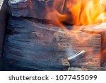 a fire from logs that burn... | Shutterstock . vector #1077455099