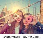 teen girls portrait with donuts ... | Shutterstock . vector #1077459581
