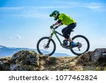 a man is riding enduro bicycle  ... | Shutterstock . vector #1077462824