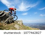 a man is riding enduro bicycle  ... | Shutterstock . vector #1077462827