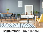 striped carpet in spacious grey ...   Shutterstock . vector #1077464561