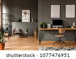 patterned posters above desk... | Shutterstock . vector #1077476951