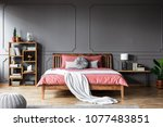 a large bed in a spacious  dark ...   Shutterstock . vector #1077483851