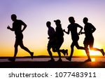 group of young people runs at... | Shutterstock . vector #1077483911