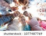 friendship of schoolchildren  | Shutterstock . vector #1077487769