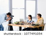 side view of multicultural... | Shutterstock . vector #1077491054
