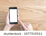 close up hand using mobile... | Shutterstock . vector #1077519311
