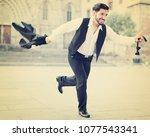 handsome emotional man in...   Shutterstock . vector #1077543341