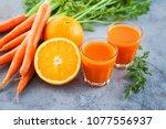 carrot and orange fresh juice... | Shutterstock . vector #1077556937
