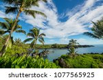 beautiful tropical beach on... | Shutterstock . vector #1077565925