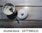 sugar bowl with a metal spoon...