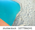 Small photo of colorful plastic pvc inflatable contrasting with white sand silica