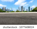 empty asphalt road and modern... | Shutterstock . vector #1077608024