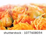 bouquet with orange roses with... | Shutterstock . vector #1077608054