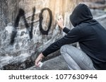 mystery man in hoody jacket... | Shutterstock . vector #1077630944