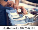 closeup of hands with wound... | Shutterstock . vector #1077647141