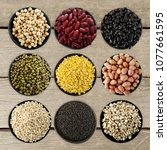 mix nuts in black bowl on... | Shutterstock . vector #1077661595