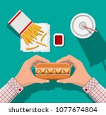 tasty hotdog  red striped paper ... | Shutterstock .eps vector #1077674804