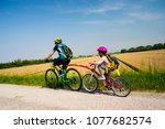 father and daughter tandem... | Shutterstock . vector #1077682574