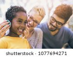 happy young mixed race couple...   Shutterstock . vector #1077694271