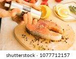 salmon steak in red curry cream ... | Shutterstock . vector #1077712157