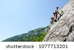 mountain guide rock climber on... | Shutterstock . vector #1077713201