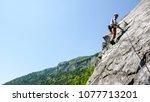 mountain guide rock climber on... | Shutterstock . vector #1077713201