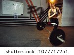 fit woman lifting heavy weights.... | Shutterstock . vector #1077717251