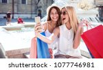shopping time. two beautiful... | Shutterstock . vector #1077746981