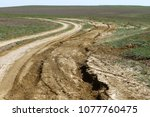 unpaved dry dirt country road...   Shutterstock . vector #1077760475