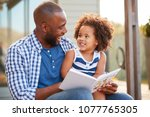 young black father and daughter ... | Shutterstock . vector #1077765305
