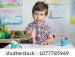 preschool kid playing and... | Shutterstock . vector #1077785969