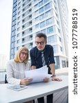 serious confident business... | Shutterstock . vector #1077788519