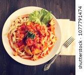 ribbon pasta with arrabiata... | Shutterstock . vector #1077791474