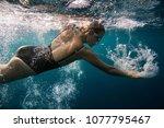 professional female swimmer... | Shutterstock . vector #1077795467