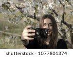 beautiful girl taking selfies.   Shutterstock . vector #1077801374