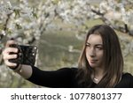 authentic girl with a black t...   Shutterstock . vector #1077801377