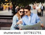 couple of tourists checking... | Shutterstock . vector #1077811751