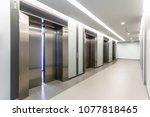 modern steel elevator door...   Shutterstock . vector #1077818465