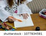 lovely child girl playing dough ... | Shutterstock . vector #1077834581