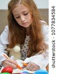 lovely child girl playing dough ... | Shutterstock . vector #1077834584