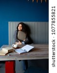 beautiful brunette sitting in... | Shutterstock . vector #1077855821