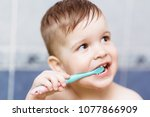 beautiful baby brushing his... | Shutterstock . vector #1077866909