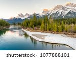 sunrise over the bow river and...   Shutterstock . vector #1077888101